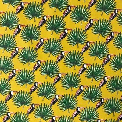 Tissu coton imprimé toucan palmier moutarde