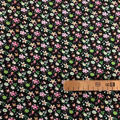 Tissu coton imprimé fleurs noires avec mètre