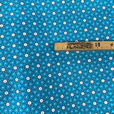 Tissu coton imprimé géométrique turquoise mètre