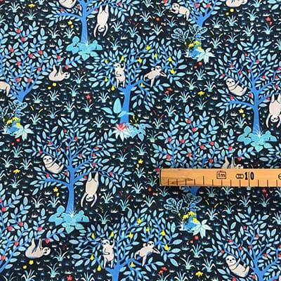 Tissu coton imprimé paresseux bleu mètre