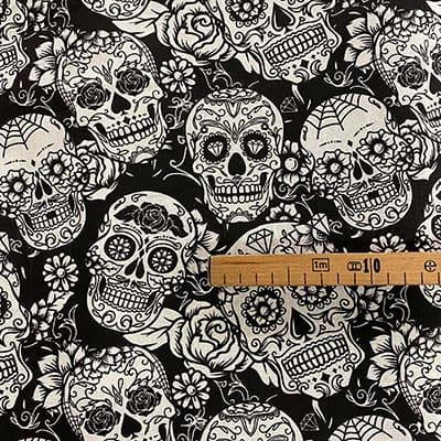 Tissu coton imprimé tête de mort noir mètre